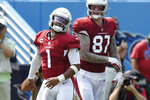 Arizona Cardinals quarterback Kyler Murray (1) is congratulated by tight end Maxx Williams (87) after Murray ran for a touchdown against the Tennessee Titans in the first half of an NFL football game Sunday, Sept. 12, 2021, in Nashville, Tenn. (AP Photo/Mark Zaleski)