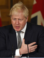 Britain's Prime Minister Boris Johnson gestures as he speaks during a press conference in 10 Downing Street, London, Saturday, Oct. 31, 2020 where he announced new restrictions to help combat a coronavirus surge. (AP Photo/Alberto Pezzali, Pool)