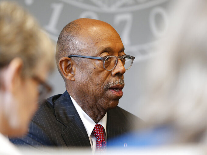 Ohio State University president Michael Drake answers questions during an interview about the accusations against former Ohio State team doctor Richard Strauss Friday, May 17, 2019, in Columbus, Ohio. An investigation found that Strauss sexually abused at least 177 athletes from at least 16 sports as well as others from his work at the student health center and his off-campus clinic. (AP Photo/Jay LaPrete)