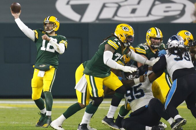 Green Bay Packers' Aaron Rodgers throws a pass during the second half of an NFL football game Saturday, Dec. 19, 2020, in Green Bay, Wis. (AP Photo/Matt Ludtke)