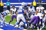 Indianapolis Colts running back Jonathan Taylor (28) leaps over for a touchdown against the Baltimore Ravens in the first half of an NFL football game in Indianapolis, Sunday, Nov. 8, 2020. (AP Photo/AJ Mast)