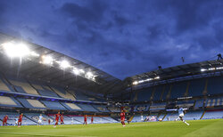 Manchester City's Benjamin Mendy kicks the ball during the English Premier League soccer match between Manchester City and Liverpool at Etihad Stadium in Manchester, England, Thursday, July 2, 2020. (AP Photo/Peter Powell,Pool)