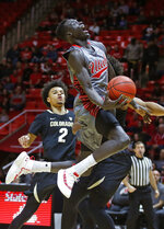 Utah forward Both Gach, right, lays the ball up as Colorado guard Daylen Kountz (2) looks on during the second half in an NCAA college basketball game Sunday, Jan. 20, 2019, in Salt lake City. (AP Photo/Rick Bowmer)