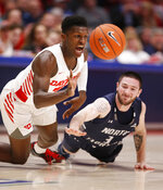 Dayton guard Dwayne Cohill, left, and North Florida guard J.T. Escobar, right, fight for the ball during the first half of an NCAA college basketball game, Monday Dec. 30, 2019, in Dayton. (AP Photo/Gary Landers)