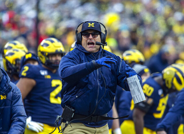 Michigan head coach Jim Harbaugh calls a timeout in the third quarter of an NCAA college football game against Ohio State in Ann Arbor, Mich., Saturday, Nov. 30, 2019. Ohio State won 56-27. (AP Photo/Tony Ding)