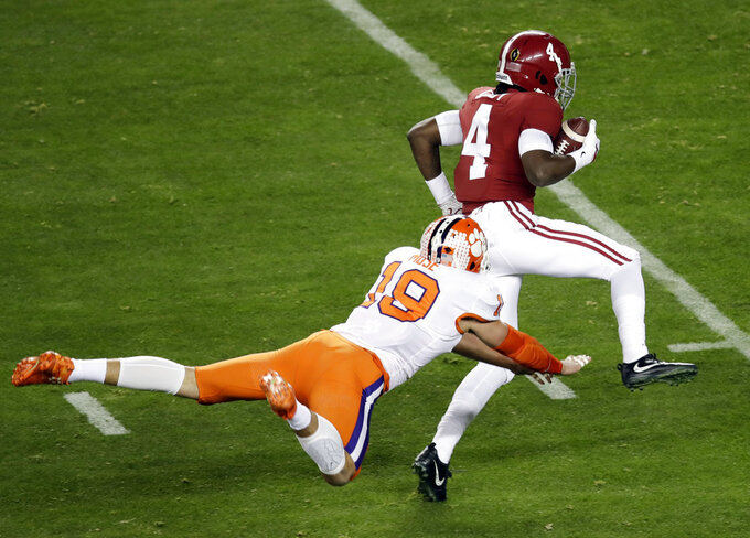 Alabama's Jerry Jeudy gets past Clemson's Tanner Muse for a touchdown during the first half the NCAA college football playoff championship game, Monday, Jan. 7, 2019, in Santa Clara, Calif. (AP Photo/Jeff Chiu)