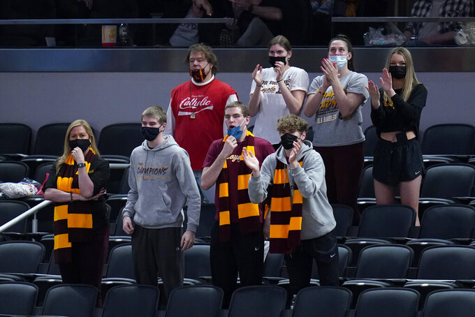 Fans react during the second half of a Sweet 16 game between Loyola Chicago and Oregon State in the NCAA men's college basketball tournament at Bankers Life Fieldhouse, Saturday, March 27, 2021, in Indianapolis. (AP Photo/Jeff Roberson)