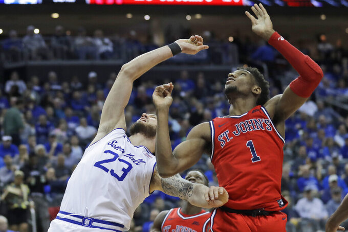 St. John's Josh Roberts, right, fouls Seton Hall's Sandro Mamukelashvili during the second half of an NCAA college basketball game in Newark, N.J., Sunday, Feb. 23, 2020. Seton Hall defeated St. John's 81-65. (AP Photo/Seth Wenig)