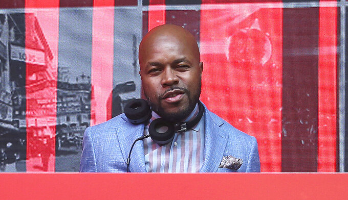 FILE - This June 4, 2018 file photo shows DJ D-Nice, whose real name is Derrick Jones, at the 13th Annual Apollo Theater Spring Gala After Party in New York. The DJ is among the entertainers who took the initiative to make the best out of a challenging year. During the pandemic's early stage, he hosted Homeschool at Club Quarantine on his Instagram Live, where he spun popular tunes on the turntables at his home. (Photo by Donald Traill/Invision/AP, File)