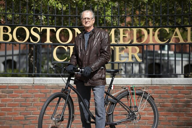In this Saturday, May 9, 2020, photo, attorney Clyde Bergstresser poses outside Boston Medical Center in Boston. During a storied legal career, Bergstresser has become one of the go-to medical malpractice lawyers in Massachusetts. But as COVID-19 cases surged at Boston area hospitals, Bergstresser found his sympathies aligning with the professions he has often fingered in million-dollar lawsuits. (AP Photo/Michael Dwyer)