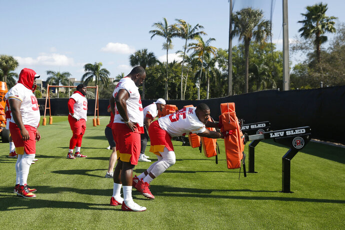 Kansas City Chiefs defensive end Chris Jones (95) runs drills during practice on Wednesday, Jan. 29, 2020, in Davie, Fla., for the NFL Super Bowl 54 football game. (AP Photo/Brynn Anderson)