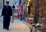 New York City firefighters take a position in front of a memorial on the side of a firehouse adjacent to One World Trade Center and the 9/11 Memorial site during ceremonies commemorating the 18th anniversary of the 9/11 terrorist attacks in New York on Wednesday, Sept. 11, 2019. (AP Photo/Craig Ruttle)