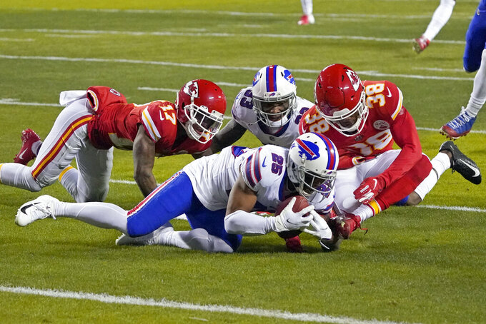 Buffalo Bills running back Taiwan Jones (25) recovers a fumble ahead of Kansas City Chiefs safety L'Jarius Sneed (38) during the first half of the AFC championship NFL football game, Sunday, Jan. 24, 2021, in Kansas City, Mo. (AP Photo/Jeff Roberson)