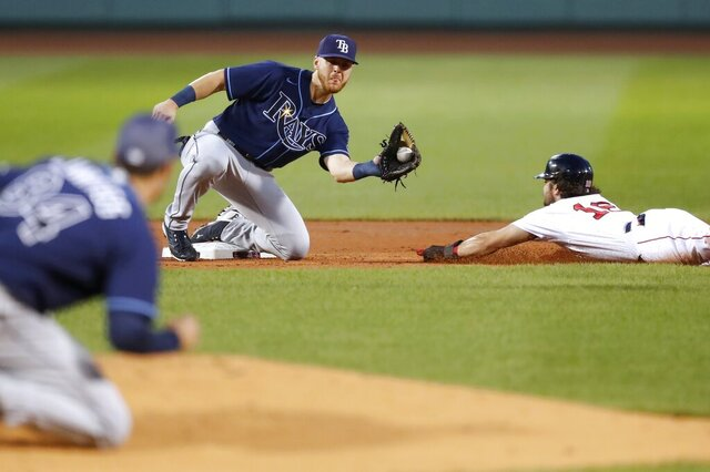 Tampa Bay Rays' Michael Brosseau, center, gets the throw at second base on the attempted steal by Boston Red Sox's Andrew Benintendi during the first inning of a baseball game, Tuesday, Aug. 11, 2020, in Boston. (AP Photo/Michael Dwyer)