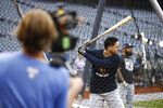 Milwaukee Brewers' Ryan Braun takes part in batting practice, Monday, Sept. 30, 2019, in Washington. The Brewers are scheduled to face the Washington Nationals in a National League wild-card baseball game Tuesday, Oct. 1. (AP Photo/Patrick Semansky)