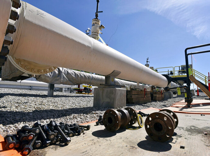 FILE - In this June 8, 2017, file photo, fresh nuts, bolts and fittings are ready to be added to the east leg of the pipeline near St. Ignace, Mich., as Enbridge Inc., prepares to test the east and west sides of the Line 5 pipeline under the Straits of Mackinac in Mackinaw City, Mich. Michigan Gov. Gretchen Whitmer says she's open to allowing construction of an oil pipeline tunnel beneath the channel where Lakes Huron and Michigan meet. Whitmer told reporters Wednesday, APRIL 17, 2019, in Lansing, her goal remains getting Enbridge's Line 5 out of the Straits of Mackinac as quickly as possible. (Dale G Young/Detroit News via AP, File)