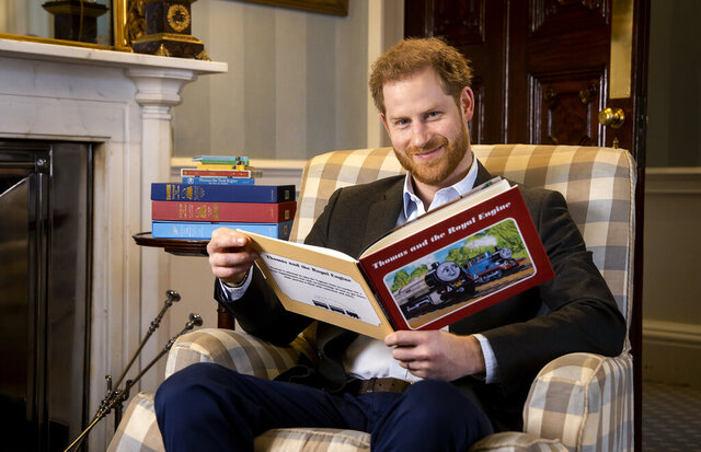 In this January, 2020 photo and made available on Monday April 27, 2020 by Mattel, Britain's Prince Harry poses for a photo during the recording of his introduction to the new animated special 'Thomas & Friends: The Royal Engine'. Set when the the Prince Harry's father, Prince Charles was a boy, Thomas has to take Sir Topham Hatt, the controller of the railway, to Buckingham Palace to receive an honour. The special will be screened in the US on Netflix on 1 May, 2020 and in the UK on Channel 5 Milkshake at 9:05 am on 2 May, 2020. (Dave Poultney/Mattel via AP)