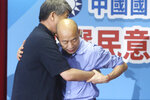 Kaohsiung city mayor Han Kuo-yu, right, holds his party colleague Chang Ya-chung after winning the candidacy of the opposition of the Nationalist Party (KMT) for the upcoming presidential elections at the party headquarters, Monday, July 15, 2019, in Taipei, Taiwan. (AP Photo/Chiang Ying-ying)