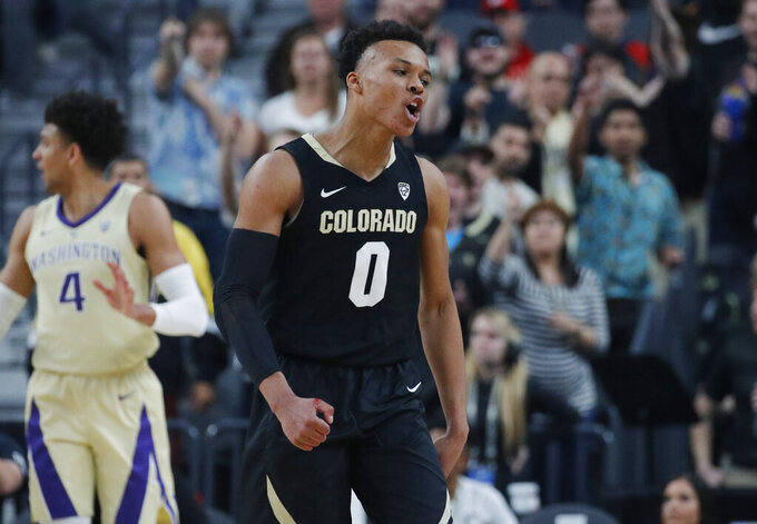 Colorado's Shane Gatling celebrates after a play against Washington during the first half of an NCAA college basketball game in the semifinals of the Pac-12 men's tournament Friday, March 15, 2019, in Las Vegas. (AP Photo/John Locher)