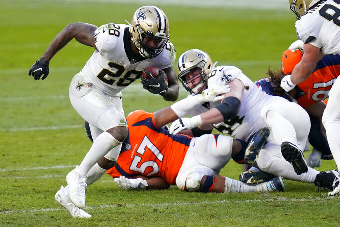 New Orleans Saints running back Latavius Murray (28) runs for a touchdown against the Denver Broncos during the second half of an NFL football game, Sunday, Nov. 29, 2020, in Denver. (AP Photo/David Zalubowski)