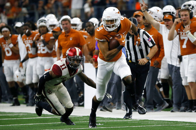FILE - In this Dec. 1, 2018, file photo, Texas wide receiver Collin Johnson (9) runs as Oklahoma cornerback Parnell Motley (11) attempts a tackle during the first half of the NCAA Big 12 Conference football championship, in Arlington, Texas. Texas opens the 2019 season against Louisiana Tech of Conference USA on Saturday night, Aug. 31, 2019. (AP Photo/Roger Steinman, File)