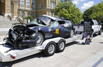 A wrecked Iowa State Patrol car sits on display during a news conference announcing the Iowa Traffic Fatality Reduction Task Force at the Iowa Capitol Building in Des Moines on Tuesday, June 8, 2021. (Bryon Houlgrave/The Des Moines Register via AP)/The Des Moines Register via AP)