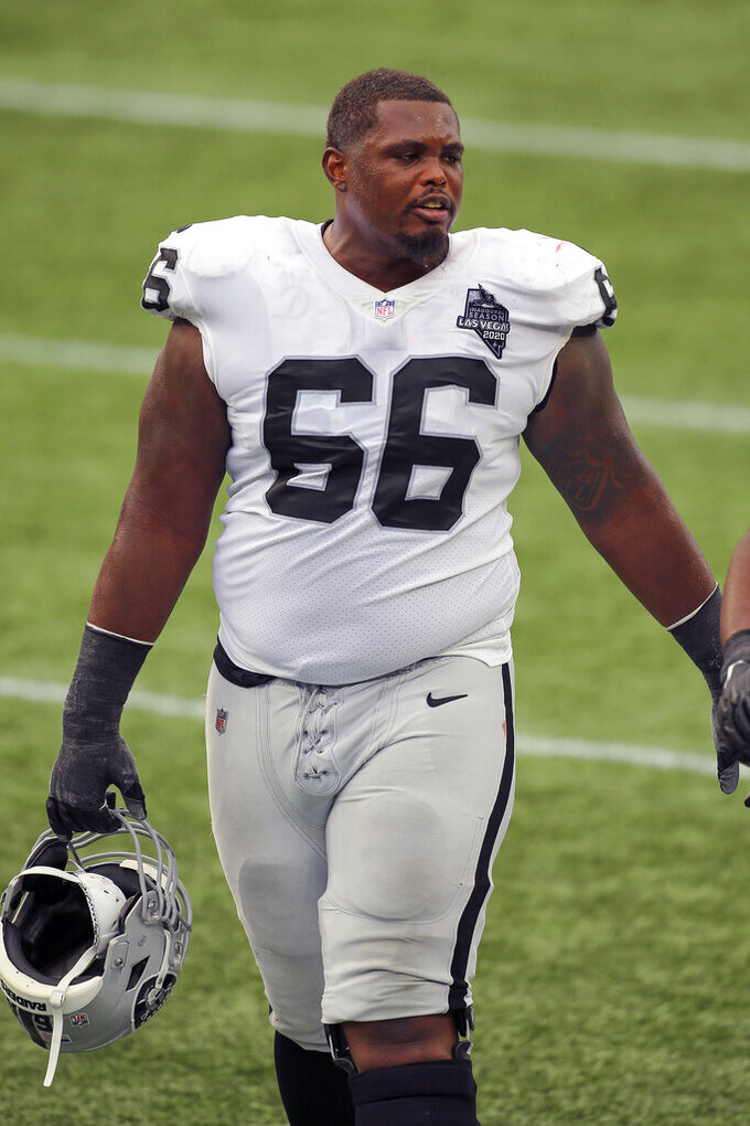 FILE - Then-Las Vegas Raiders guard Gabe Jackson (66) is shown following an NFL football game against the New England Patriots in Foxborough, Mass., in this Sunday, Sept. 27, 2020, file photo. Russell Wilson wanted the Seattle Seahawks to upgrade his protection. Enter Gabe Jackson, the veteran who suddenly became available via trade from the Las Vegas Raiders. (AP Photo/Stew Milne, File)
