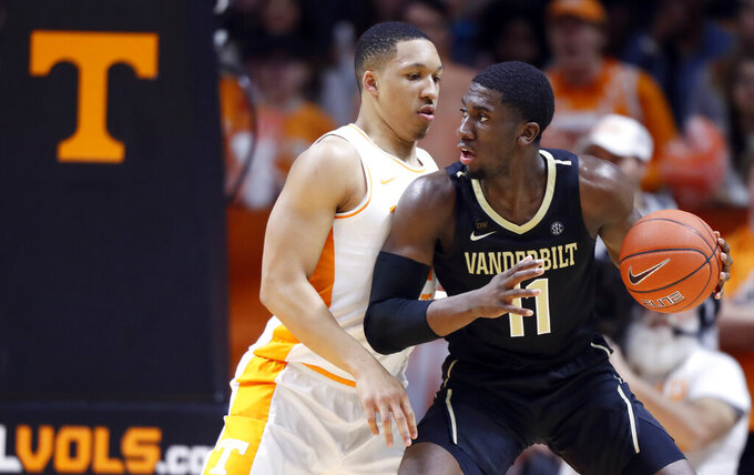 Vanderbilt forward Simisola Shittu (11) works for a shot as Tennessee forward Grant Williams defends during the first half of an NCAA college basketball game Tuesday, Feb. 19, 2019, in Knoxville, Tenn. (AP photo/Wade Payne)