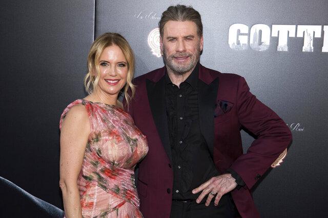 FILE - In this June 14, 2018, file photo, Kelly Preston and John Travolta attend the premiere of