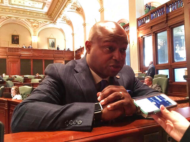 """Rep. Emanuel """"Chris"""" Welch, D-Hillside, talks to reporters on the House floor, Monday, May 29, 2017, in Springfield, Ill. Welch, chairman of the Special Investigating Committee probing allegations of misconduct by Democratic House Speaker Michael Madigan, has delayed further hearings until after the Nov. 3, 2020, election. Madigan is implicated in a decade-long bribery scheme to which utility giant ComEd has admitted in a deferred prosecution agreement with the Justice Department. Madigan has not been charged with a crime and denies wrongdoing. (AP Photo/John O'Connor)"""