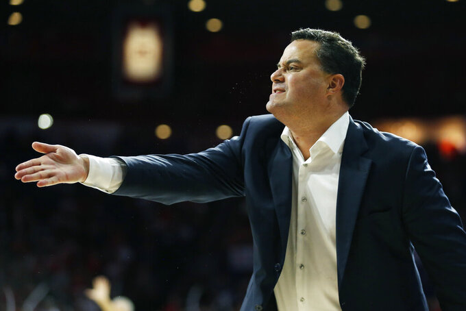 Arizona coach Sean Miller reacts to a foul call during the second half of the team's NCAA college basketball game against Northern Arizona, Wednesday, Nov. 6, 2019, in Tucson, Ariz. (AP Photo/Rick Scuteri)