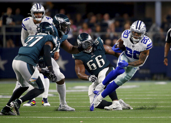 Philadelphia Eagles' Malcolm Jenkins (27) and Akeem Spence (66) attempt to stop Dallas Cowboys running back Tony Pollard (20) in the first half of an NFL football game in Arlington, Texas, Sunday, Oct. 20, 2019. (AP Photo/Ron Jenkins)