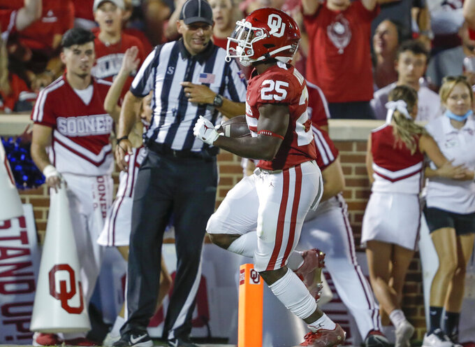 Oklahoma running back Jaden Knowles (25) scores a touchdown against Western Carolina during the second half of an NCAA college football game Saturday, Sept. 11, 2021, in Norman, Okla. Oklahoma won 76-0. (AP Photo/Alonzo Adams)