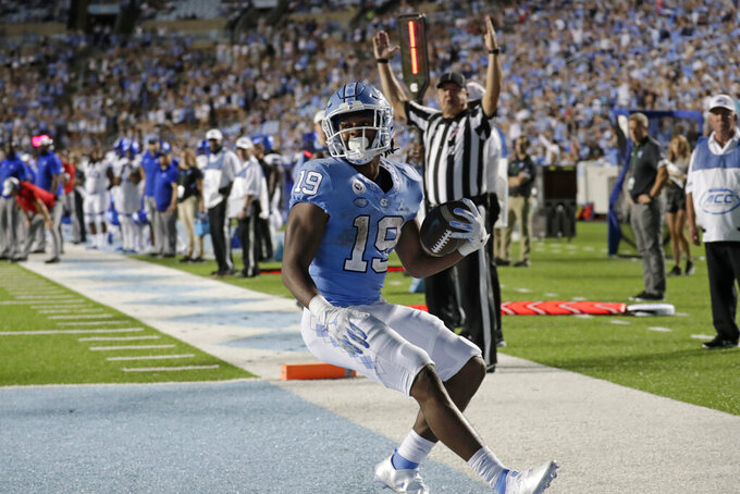 North Carolina running back Ty Chandler (19) runs into the end zone for a touchdown during the second half of an NCAA college football game against Georgia State in Chapel Hill, N.C., Saturday, Sept. 11, 2021. (AP Photo/Chris Seward)