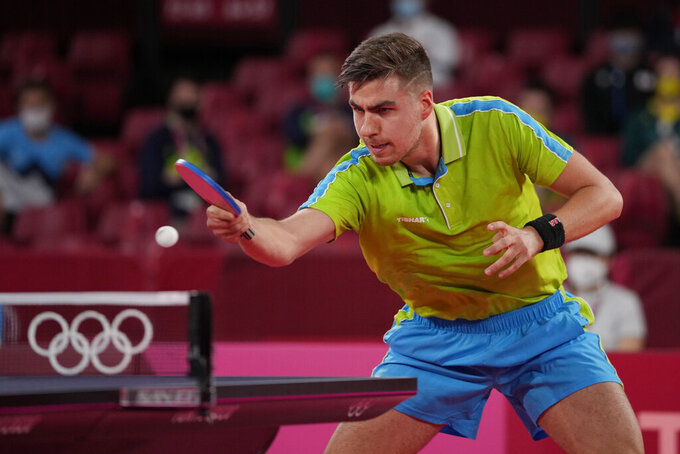 Slovenia's Jorgic Darko competes during the table tennis men's singles round of 16 match against Japan's Tomokazu Harimoto at the 2020 Summer Olympics, Tuesday, July 27, 2021, in Tokyo. (AP Photo/Kin Cheung)