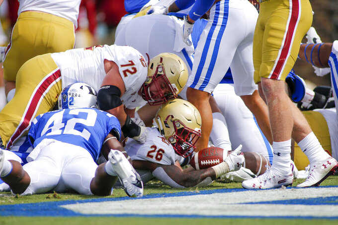 Boston College running back David Bailey (26) rushes for a touchdown against Duke during the first half of an NCAA college football game, Saturday, Sept. 19, 2020, in Durham, N.C. (Nell Redmond/Pool Photo via AP)