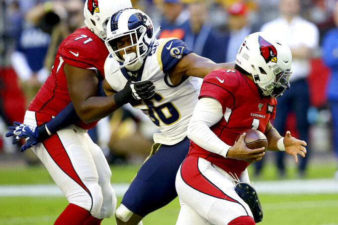 Los Angeles Rams defensive end Dante Fowler, left, sacks Arizona Cardinals quarterback Kyler Murray during the first half of an NFL football game, Sunday, Dec. 1, 2019, in Glendale, Ariz. (AP Photo/Ross D. Franklin)