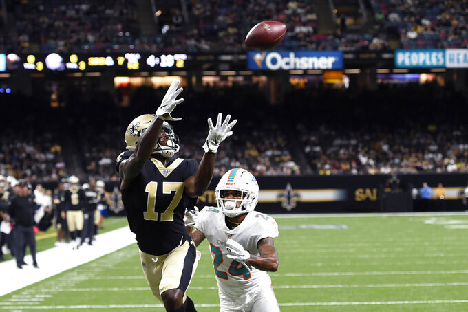 New Orleans Saints wide receiver Emmanuel Butler (17) pulls in a touchdown pass in front of Miami Dolphins cornerback Torry McTyer (24) in the first half of an NFL preseason football game in New Orleans, Thursday, Aug. 29, 2019. (AP Photo/Bill Feig)
