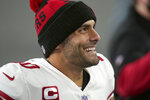 San Francisco 49ers quarterback Jimmy Garoppolo smiles after defeating the New England Patriots in an NFL football game, Sunday, Oct. 25, 2020, in Foxborough, Mass. (AP Photo/Steven Senne)