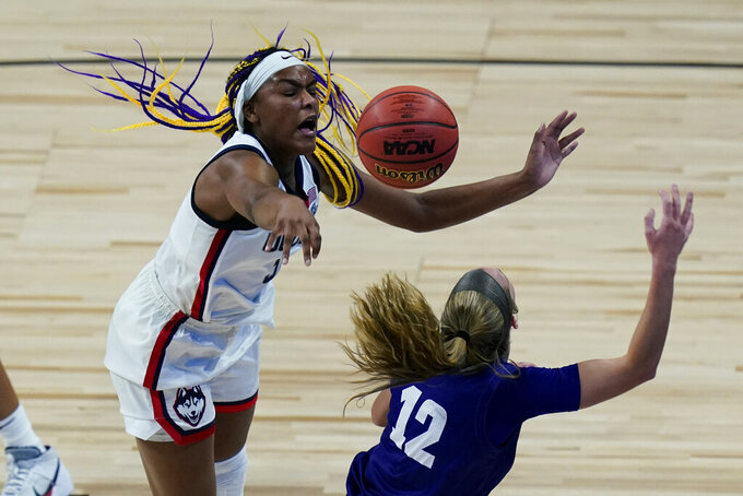 UConn forward Aaliyah Edwards (3) blocks High Point guard Jenson Edwards (12) as she tries to score during the second half of a college basketball game in the first round of the women's NCAA tournament at the Alamodome in San Antonio, Sunday, March 21, 2021. (AP Photo/Eric Gay)
