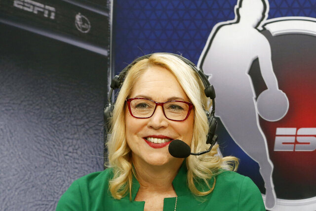 FILE - ESPN announcer Doris Burke is shown prior to an NBA basketball game between the New Orleans Pelicans and the Dallas Mavericks in Dallas, Wednesday, March 4, 2020. Burke will set another milestone later this month when she calls the conference and NBA Finals for ESPN Radio. Burke will be the first woman to serve as a game analyst on a network television or radio broadcast this deep into the postseason. (AP Photo/Michael Ainsworth, File)