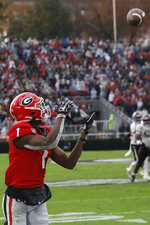 Georgia wide receiver George Pickens (1) looks to bring in a pass from Georgia quarterback Jake Fromm (11) in the first half of an NCAA football game between Georgia and Texas A&M in Athens, Ga., on Saturday, Nov. 23, 2019. (Joshua L. Jones/Athens Banner-Herald via AP)