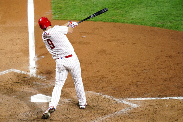 Philadelphia Phillies' Jay Bruce follows through after hitting a home run off Washington Nationals pitcher Max Scherzer during the sixth inning of a baseball game, Wednesday, Sept. 2, 2020, in Philadelphia. (AP Photo/Matt Slocum)