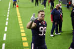 Houston Texans defensive end J.J. Watt (99) waves to fans as he walks off the field after an NFL football game against the Tennessee Titans Sunday, Jan. 3, 2021, in Houston. The Titans won 41-38. (AP Photo/Eric Christian Smith)