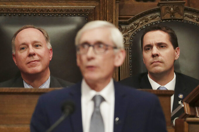 FILE - In this Jan. 22, 2020, file photo, Wisconsin Assembly Speaker Robin Vos, R-Rochester, left, and Wisconsin Senate President Roger Roth, R-Appleton, right, look on as Gov. Tony Evers delivers his State of the State address at the Wisconsin state Capitol in Madison, Wis. Gov. Evers signed a bipartisan tax cut bill into law Thursday, Feb. 18, 2021, and signaled support for another bipartisan measure to help update the state's unemployment insurance system, rare compromises that come as Republicans have roundly denounced much of his state budget proposal as a liberal wish list. (Amber Arnold/Wisconsin State Journal via AP, File)