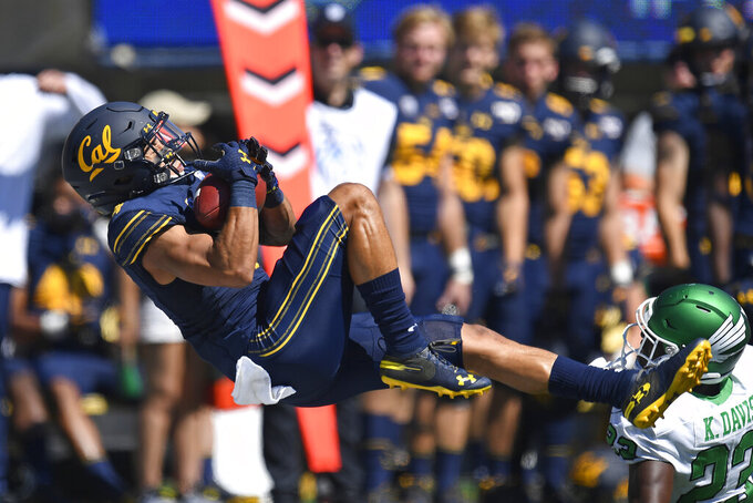 California's Nikko Remigio (4) reaches to make a catch as North Texas' Loren Easly (23) watches during the first half of an NCAA college football game at Memorial Stadium in Berkeley, Calif., on Saturday, Sept. 14, 2019. (Jose Carlos Fajardo/San Jose Mercury News via AP)