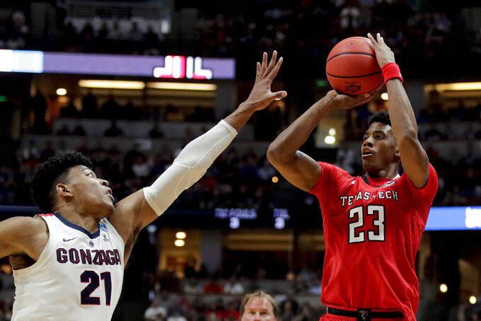 Texas Tech guard Jarrett Culver, right, shoots over Gonzaga forward Rui Hachimura during the second half of the West Regional final in the NCAA men's college basketball tournament Saturday, March 30, 2019, in Anaheim, Calif. (AP Photo/Jae C. Hong)