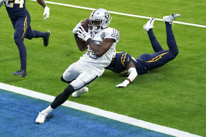 Las Vegas Raiders wide receiver Nelson Agholor scores a touchdown during the second half of an NFL football game against the Los Angeles Chargers, Sunday, Nov. 8, 2020, in Inglewood, Calif. (AP Photo/Ashley Landis)