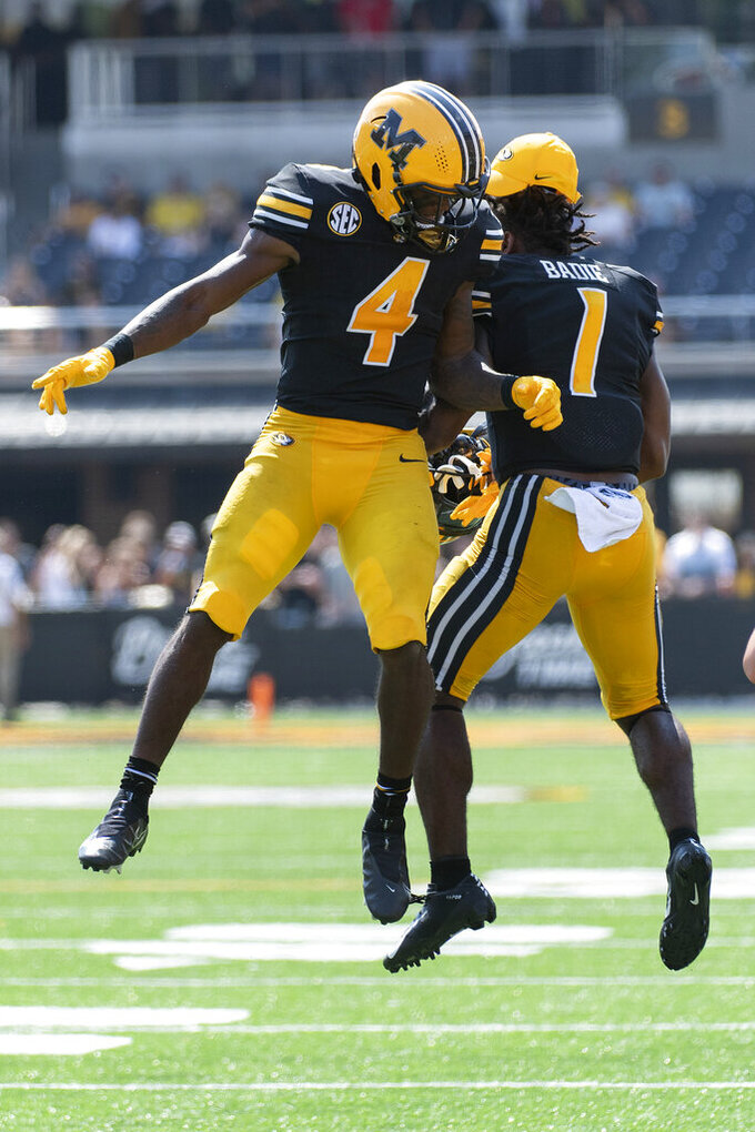 Missouri running back Elijah Young, left, celebrates his touchdown with teammate Tyler Badie, right, during the third quarter of an NCAA college football game against Southeast Missouri State, Saturday, Sept. 18, 2021, in Columbia, Mo. (AP Photo/L.G. Patterson)