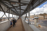 In this Friday, June 19, 2020 photo, Palestinians cross a bridge at Qalandia checkpoint between the West Bank city of Ramallah and Jerusalem, Friday, June 19, 2020. (AP Photo/Oded Balilty)